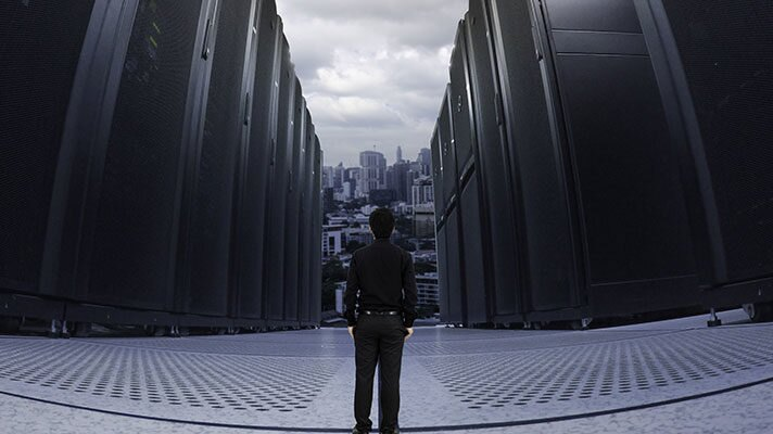 man standing in front of server aisle
